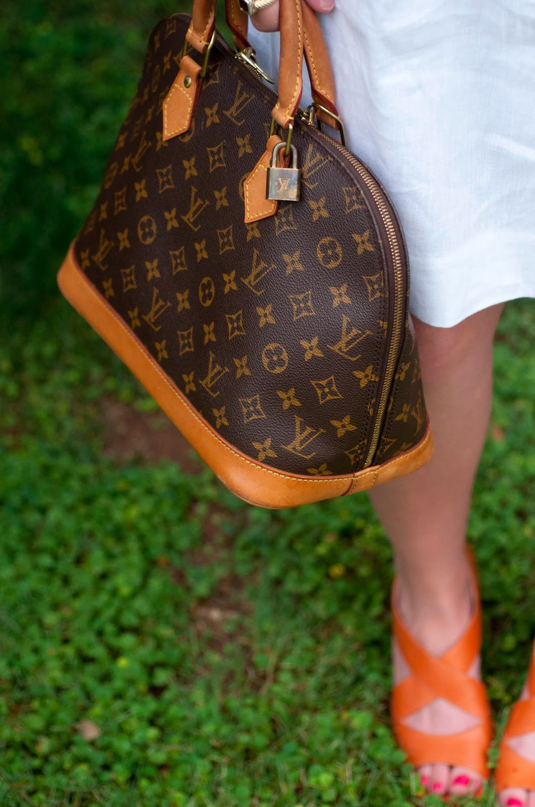 louis vuitton alma gm, louis vuitton classic monogram print, monogram print, louis vuitton, bcbg white skirt, white shirt, lv print, orange shoes