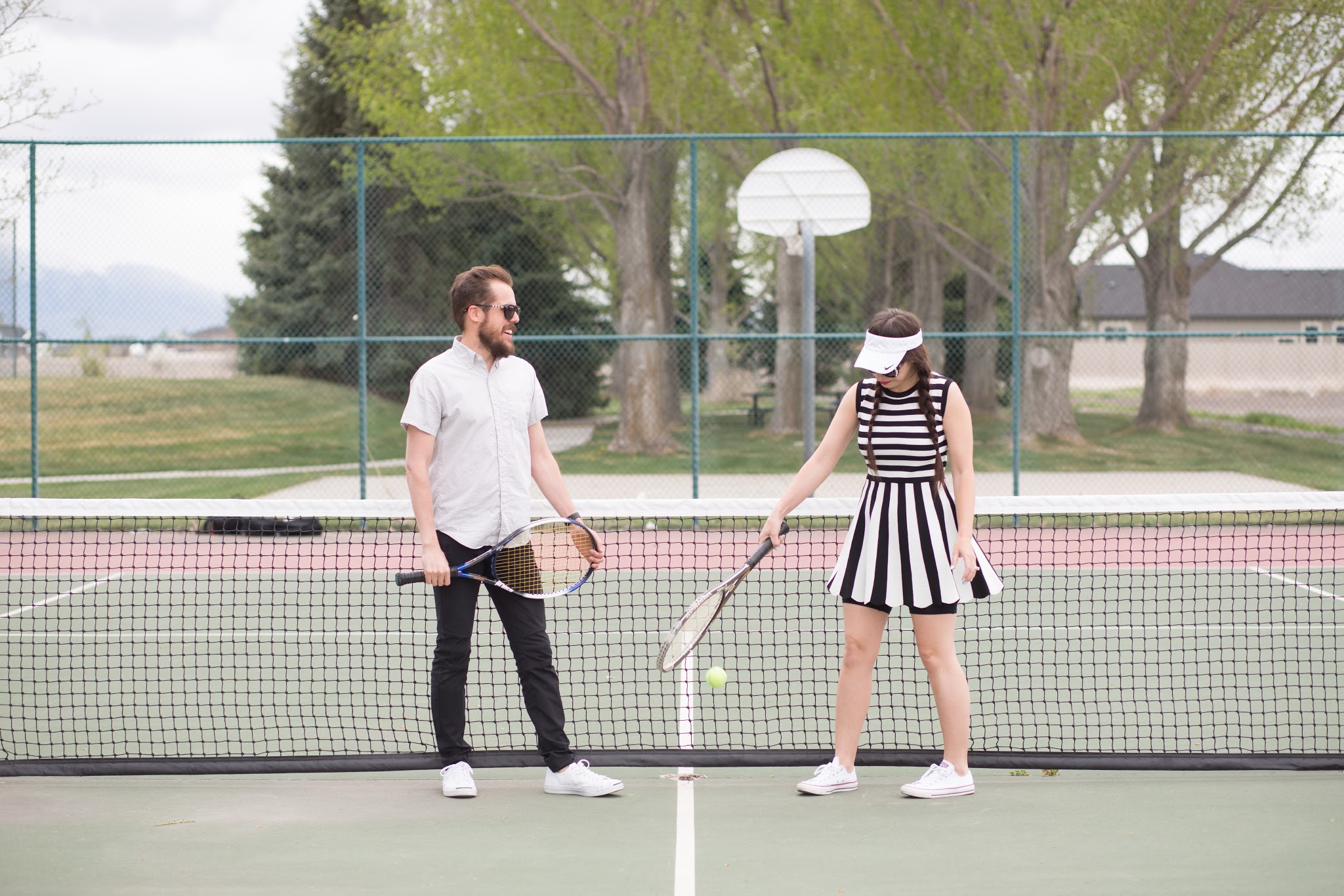 Cute Couples Playing Tennis