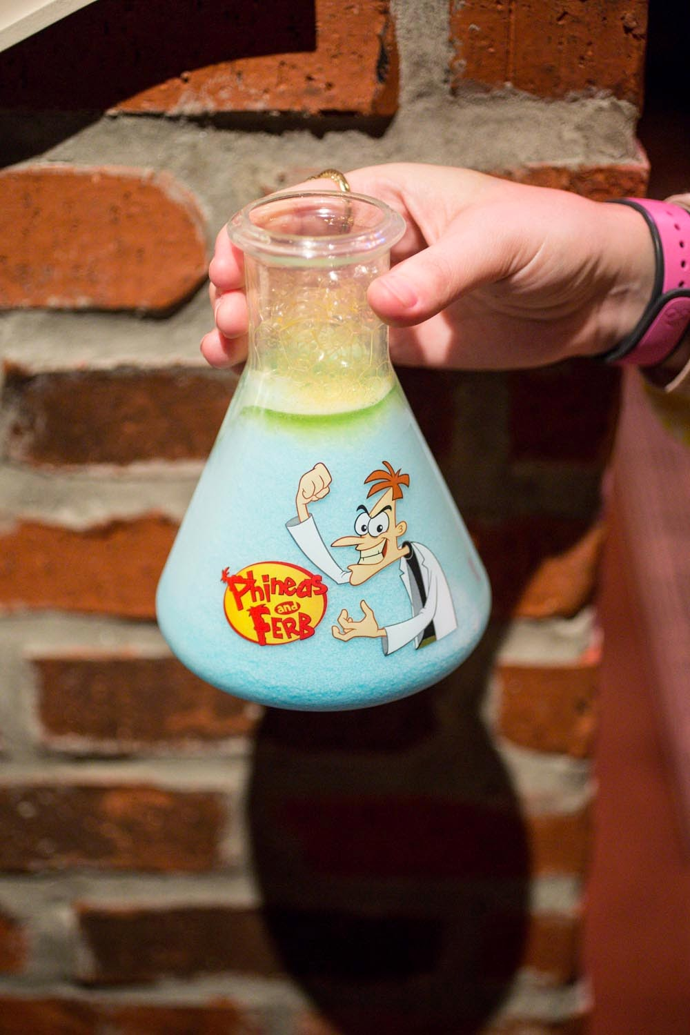 The Doofenslurper- Blue Raspberry topped with Passion Fruit Sorbet Foam