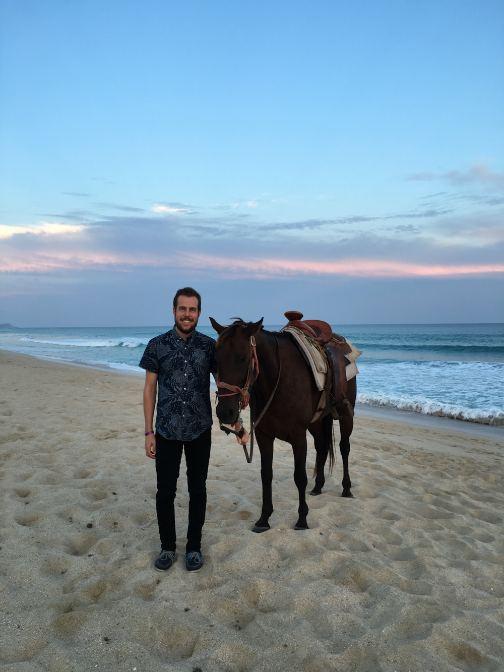 couples romantic horse ride on the beach