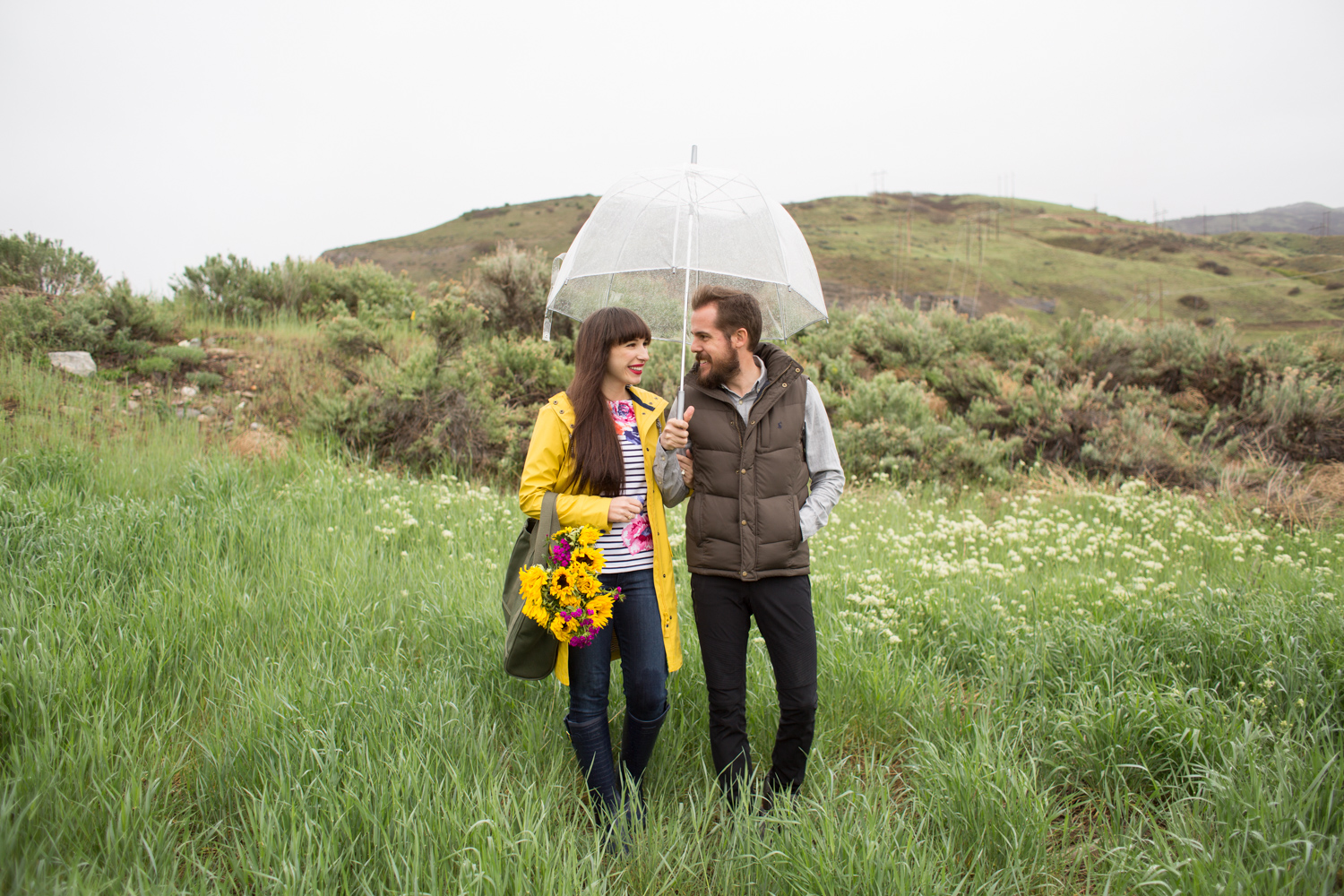 couple in joules clothing rain gear on a rainy day